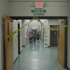 The seventh-grade hall was cordoned off as a crime scene.
