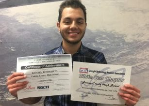 Ramtin Doroodchi holding his NOCTI Engineering Certificate and the TSA White Star Chapter Award